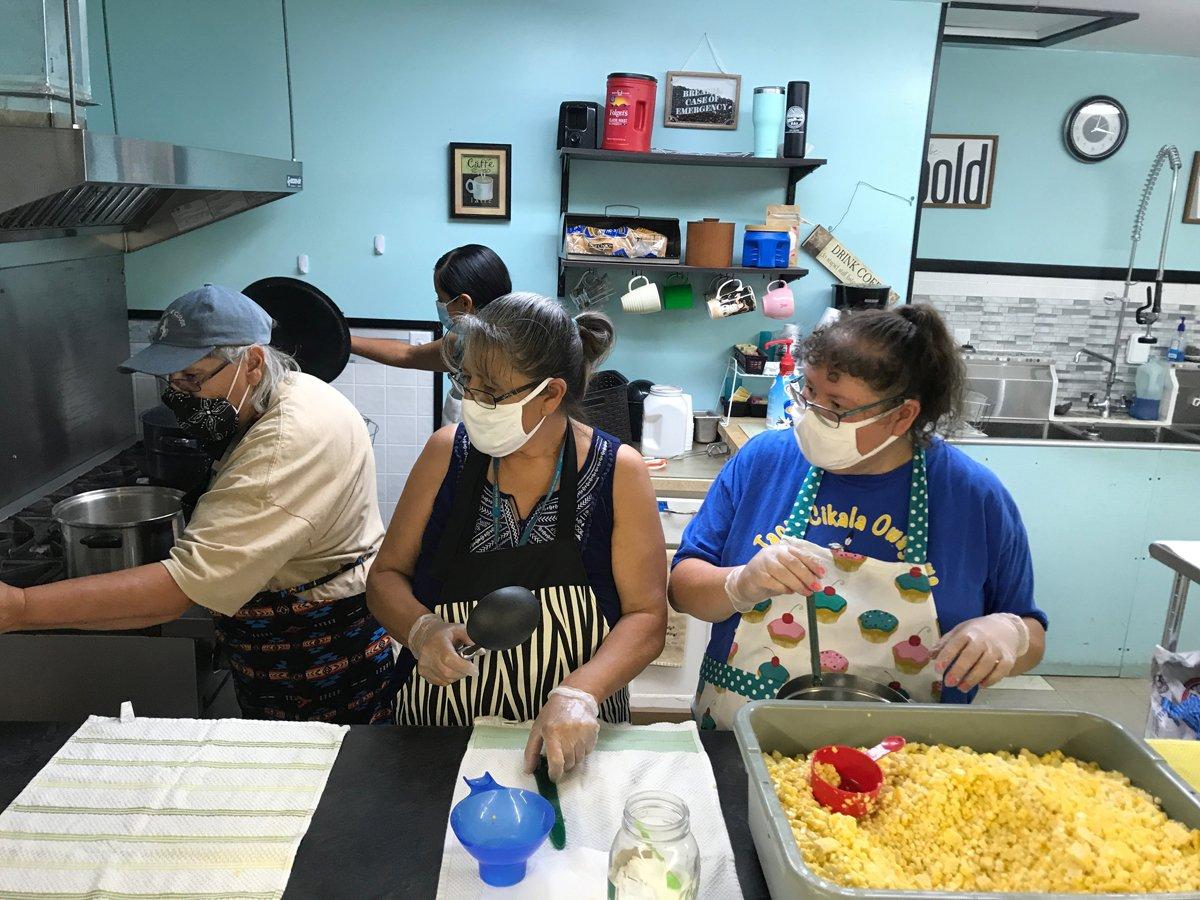Preparing corn in the Oyate Teca kitchen. (Photo courtesy of the Oyate Teca Project)