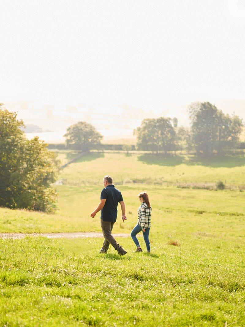 James Rebanks and his daughter walk on the farm. (Photo credit: Stuart Simpson, Penguin Books)