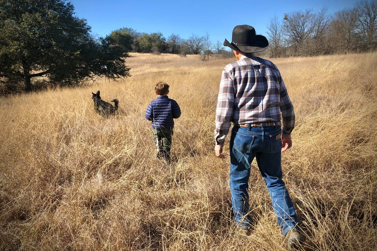 GC Ellis and his grandson walk along their ranchlands.