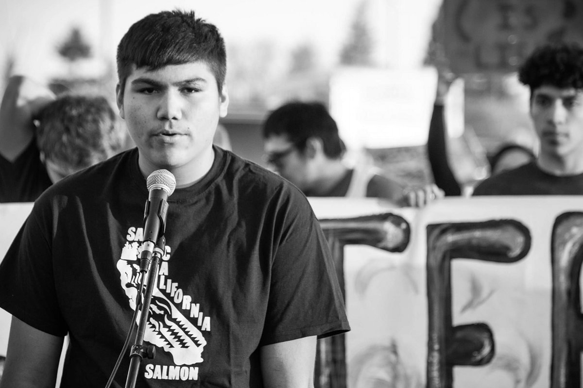 A member of the Hoopa Valley High School Water Protectors Club speaks at a 2020 rally to shut down the Delta Tunnels Project. (Photo courtesy of Wingspan Media)