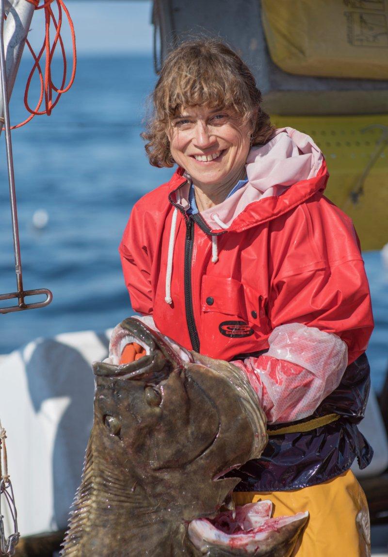 Linda Behnken holding a halibut.
