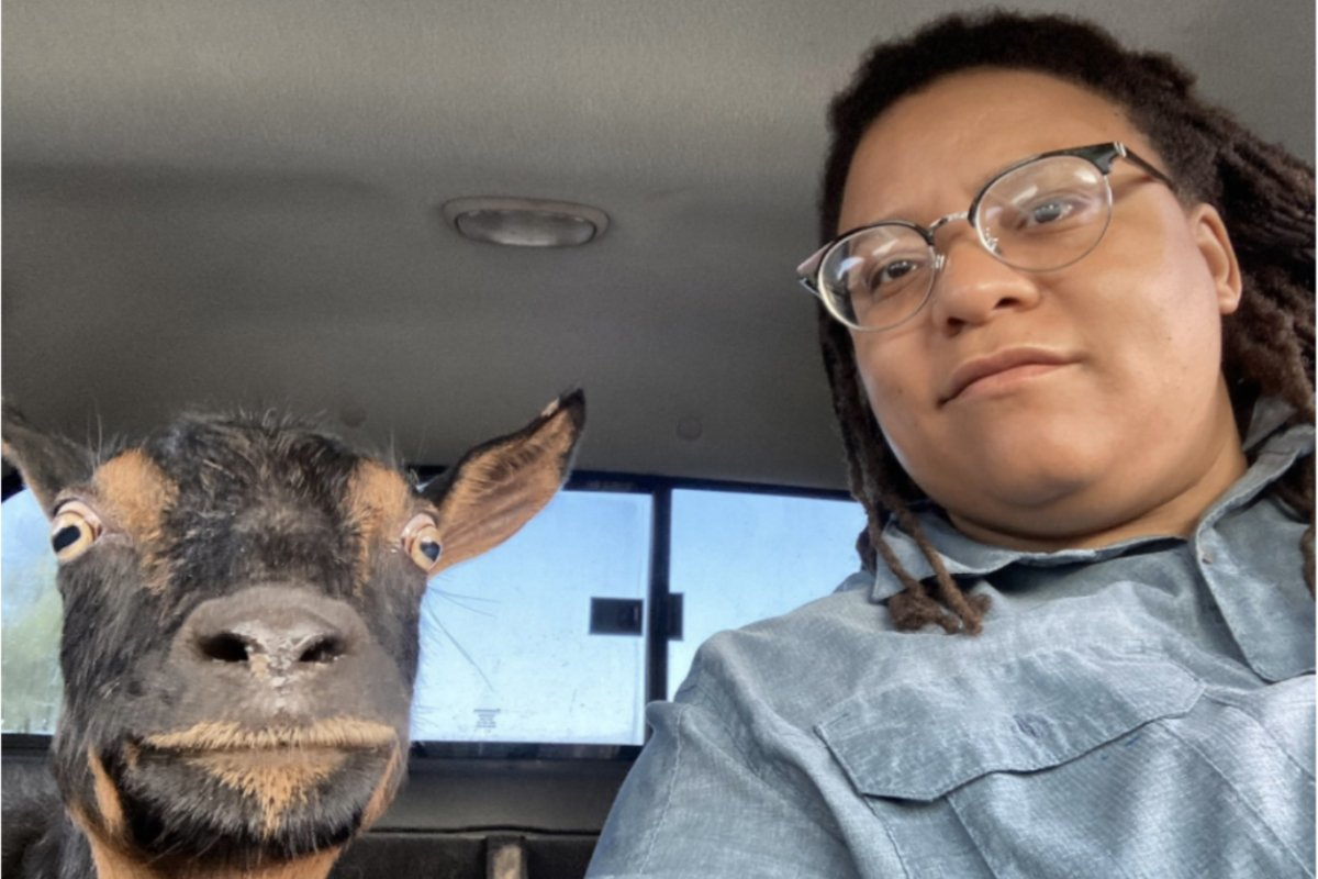 Georgia State Senator Kim Jackson, riding in a truck with one of her goats. (Photo courtesy of SIX)