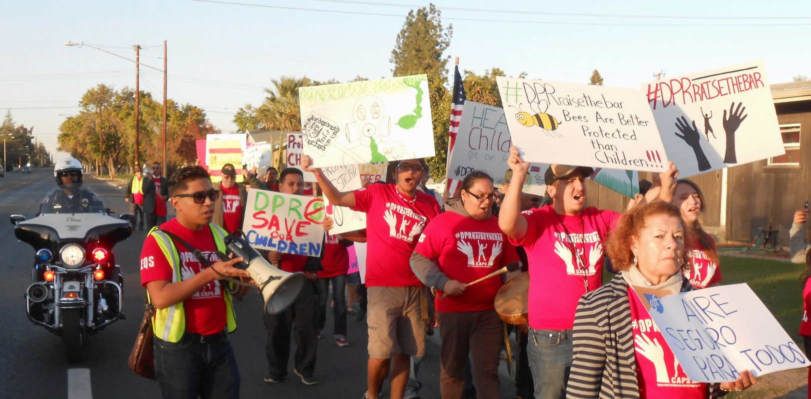 he CAPS' march in the city of Tulare, CA in 2016. The march was from a local park to the memorial hall building where California's Department of Pesticide Regulation was scheduled to host one of its statewide workshops to hear from the community on school buffer zones. (Photo courtesy of Ángel García)