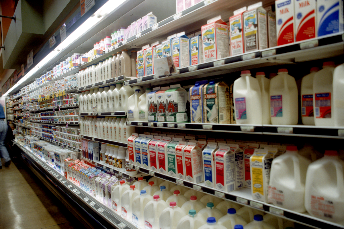 Assortment of milk in the dairy aisle of the grocery store