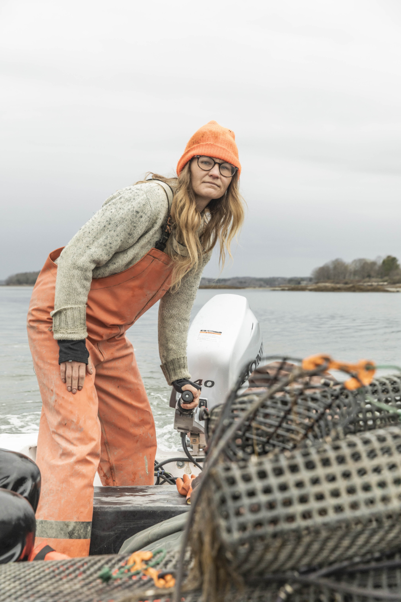 Amanda Moeser navigates her boat back to the wharf after supporting Emily Selinger during a morning of work on her oyster farm.